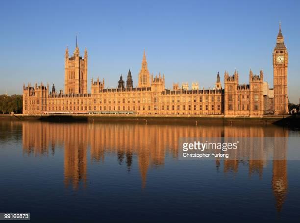 The Houses of Parliament are bathed in the early morning sunshine on May 13, 2010 in London, England. New Prime Minister David Cameron is holding his...