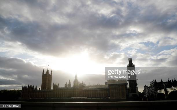 TOPSHOT The Houses of Parliament are pictured from the South Bank of the River Thames in central London on September 24 2019 after the judgement of...