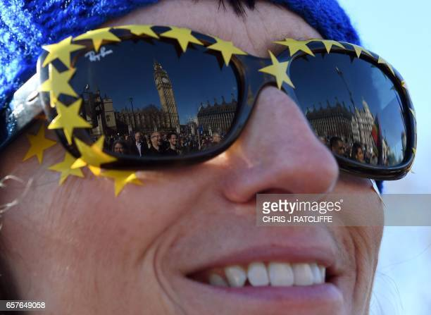 The Houses of Parliament are reflected in the sunglasses of a demonstrators as she attends a rally in Parliament Square following an anti Brexit...