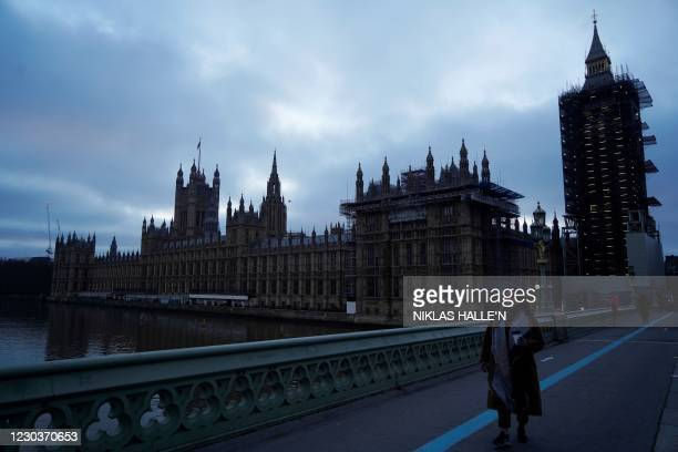The Houses of Parliament are seen at dusk in central London on December 31, 2020. - Brexit becomes a reality on on December 31 as Britain leaves...