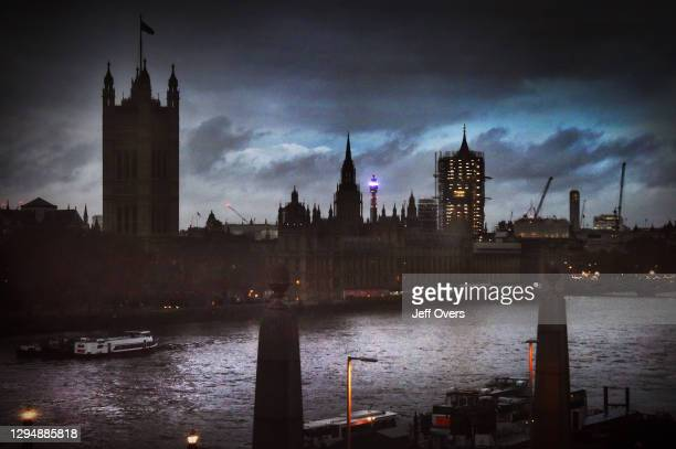 The Houses of Parliament at dusk, with Big Ben enclosed in scaffolding as it undergoes renovation on November 26, 2019 in London, United Kingdom.