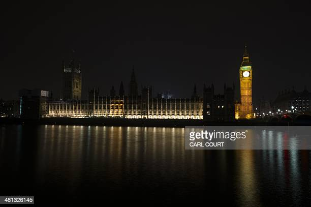 The Houses of Parliament in central London are illuminated as normal ahead of Earth Hour on March 29 2014 Britains Houses of Parliament will go dark...
