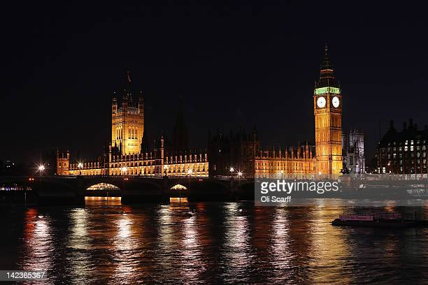 The Houses of Parliament is illuminated at night seen from across the river Thames on March 27, 2012 in London, England.