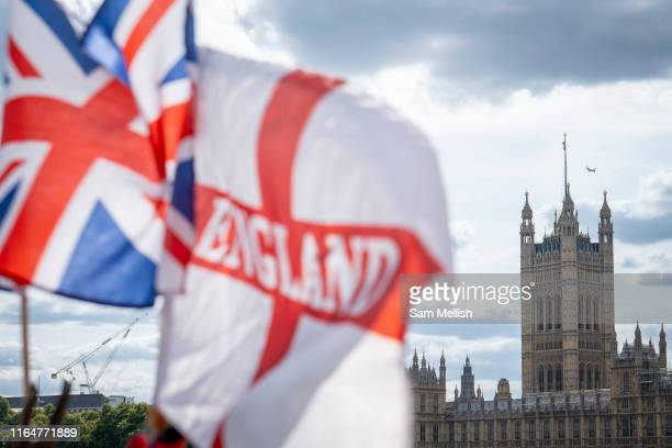 The Houses of Parliament with a Union Jack and St Georges Cross flag in the foreground on the 29th August 2019 in London in the United Kingdom.