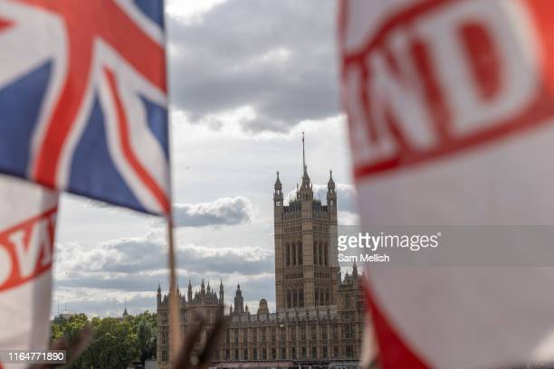 The Houses of Parliament with a Union Jack and St Georges Cross flag in the foreground on the 29th August 2019 in London in the United Kingdom