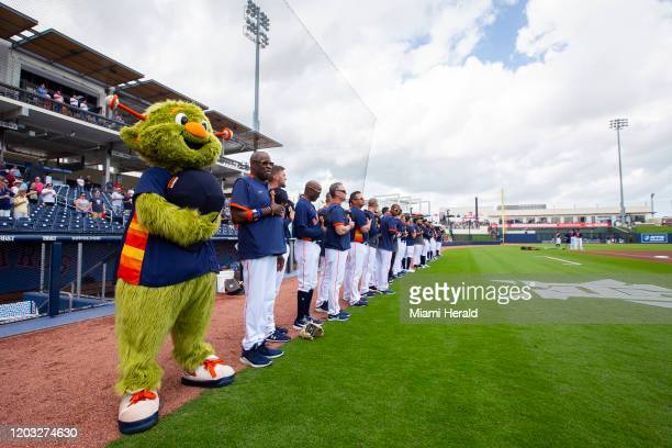 The Houston Astros baseball team line up for the national anthem ahead of a spring training game against the Miami Marlins at FITTEAM Ballpark of the...