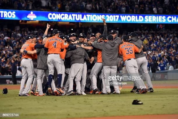 The Houston Astros celebrate after the final out of Game 7 of the 2017 World Series against the Los Angeles Dodgers at Dodger Stadium on Wednesday,...