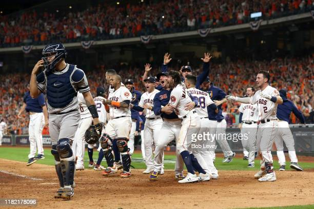 The Houston Astros celebrate their 64 win against the New York Yankees on a ninth inning walkoff home run by Jose Altuve as Gary Sanchez walks off...