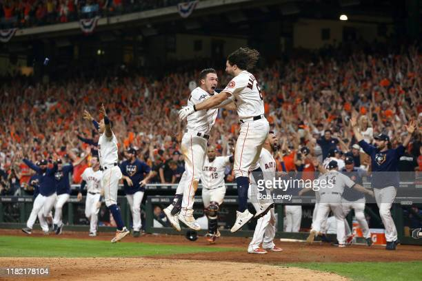 The Houston Astros celebrate their 64 win against the New York Yankees on a ninth inning walkoff home run by Jose Altuve in game six of the American...