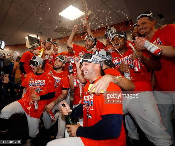 The Houston Astros celebrate winning the American League West Division after defeating the Los Angeles Angels at Minute Maid Park on September 22...