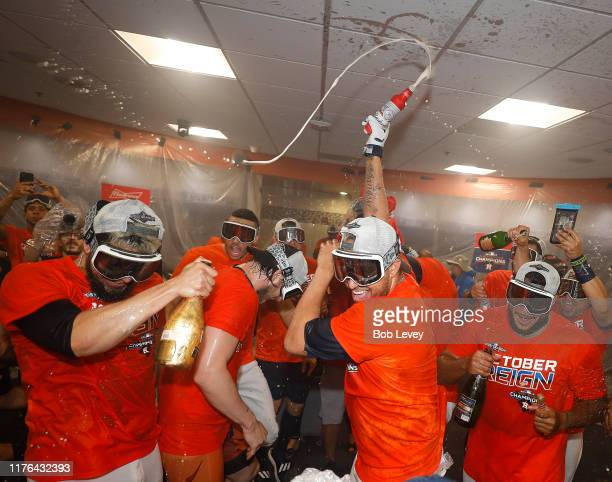 The Houston Astros celebrate winning the American League West Division after defeating the Los Angeles Angels at Minute Maid Park on September 22,...