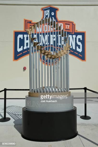The Houston Astros display their 2017 World Championship trophy on the concourse prior to the spring training game against the Boston Red Sox at The...