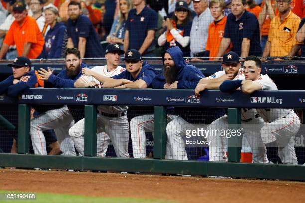 The Houston Astros dugout looks on in the ninth inning against the Boston Red Sox during Game Five of the American League Championship Series at...