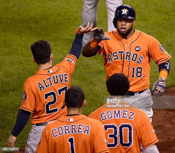 The Houston Astros' Jose Altuve celebrates with Luis Valbuena after Valbuena hit a tworun home run in the second inning against the Kansas City...