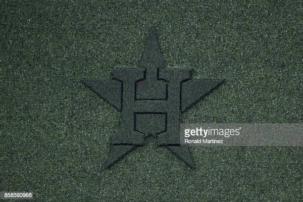 The Houston Astros logo is seen on the centerfield wall before game two of the American League Division Series between the Boston Red Sox and the...