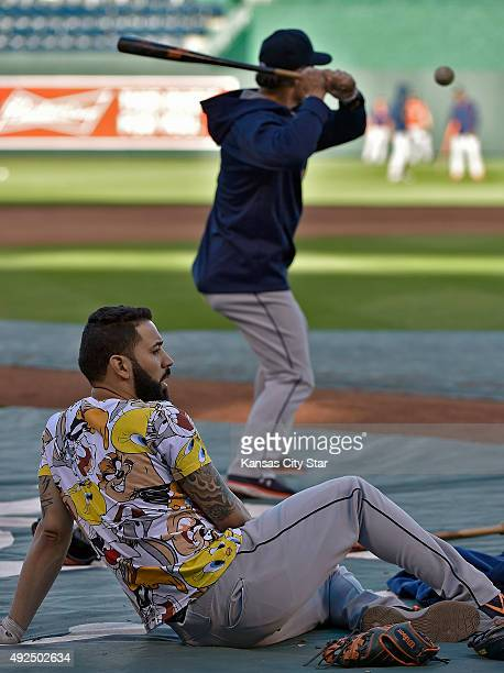The Houston Astros' Marwin Gonzalez relaxes as bench coach Trey Hillman hits fungos during a workout on Tuesday Oct 13 at Kauffman Stadium in Kansas...