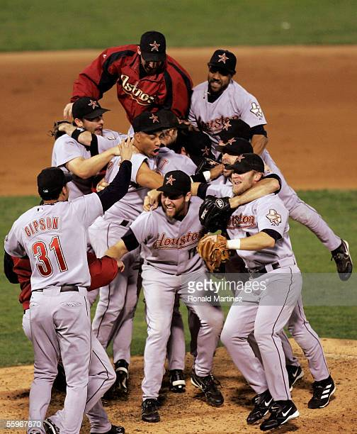 The Houston Astros pile up on each other after they defeated the St Louis Cardinals 51 in Game Six of the National League Championship Series October...