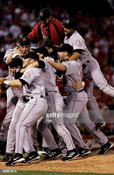 The Houston Astros pile up on each other as they celebrate their 5-1 victorory over the St. Louis Cardinals during Game Six of the National League...