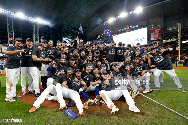 The Houston Astros pose for a photo as they celebrate their 64 win against the New York Yankees in game six of the American League Championship...