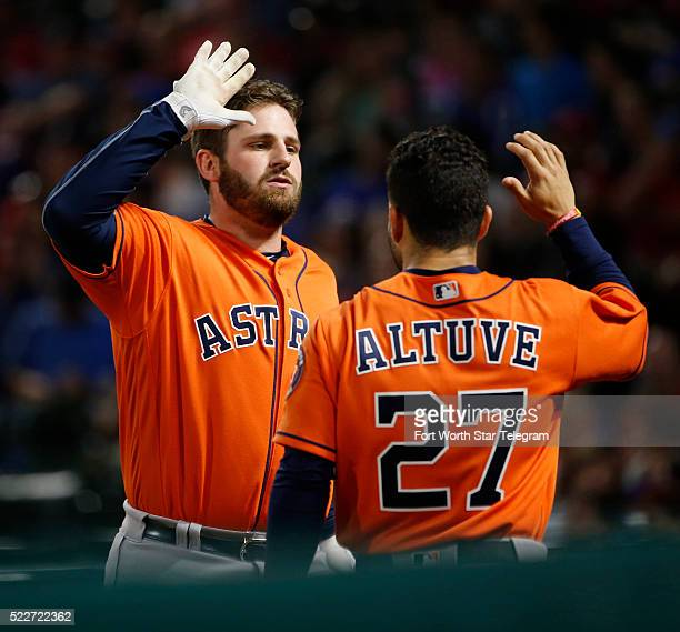 The Houston Astros' Tyler White arrives at the dugout after a solo home run in the top of the sixth inning receiving a highfive from teammate Jose...