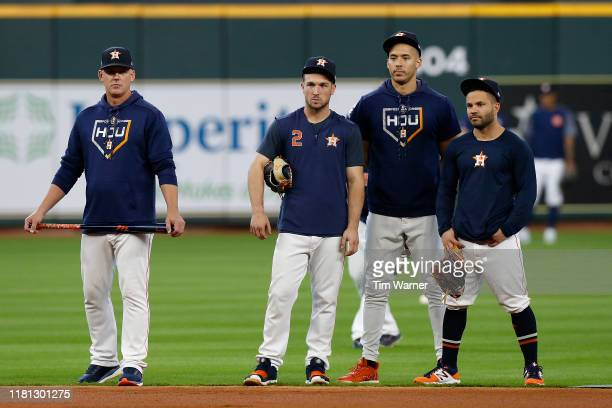 The Houston Astros watch batting practice before game five of the American League Divisional Series against the Tampa Bay Rays at Minute Maid Park on...