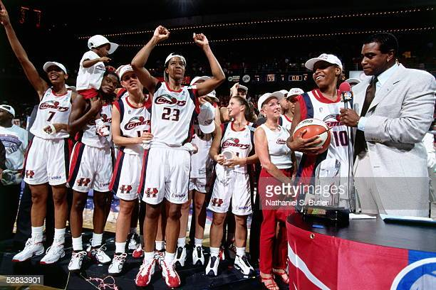 The Houston Comets celebrate at center court after winning Game 3 of the 1999 WNBA Finals at the Compaq Center on August 31 1999 in Houston Texas...