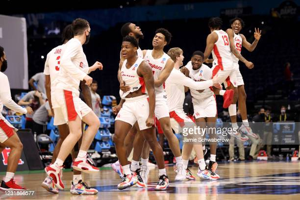 The Houston Cougars celebrate a victory over the Rutgers Scarlet Knights in the second round of the 2021 NCAA Division I Mens Basketball Tournament...