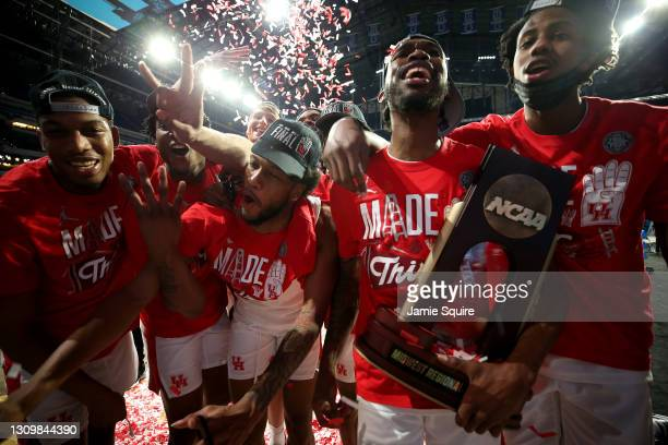 The Houston Cougars celebrate after defeating the Oregon State Beavers in the Elite Eight round of the 2021 NCAA Men's Basketball Tournament at Lucas...