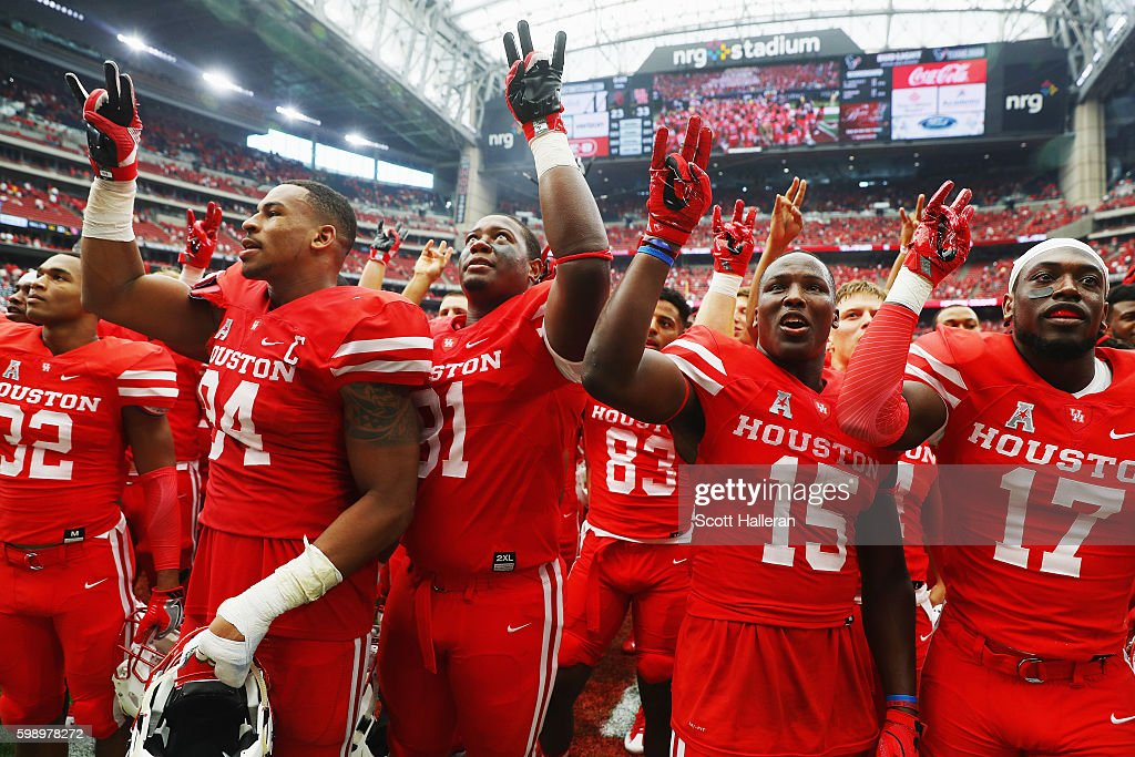 The Houston Cougars celebrate after they defeated the Oklahoma Sooners 33-23 during the Advocare Texas Kickoff on September 3, 2016 in Houston, Texas.