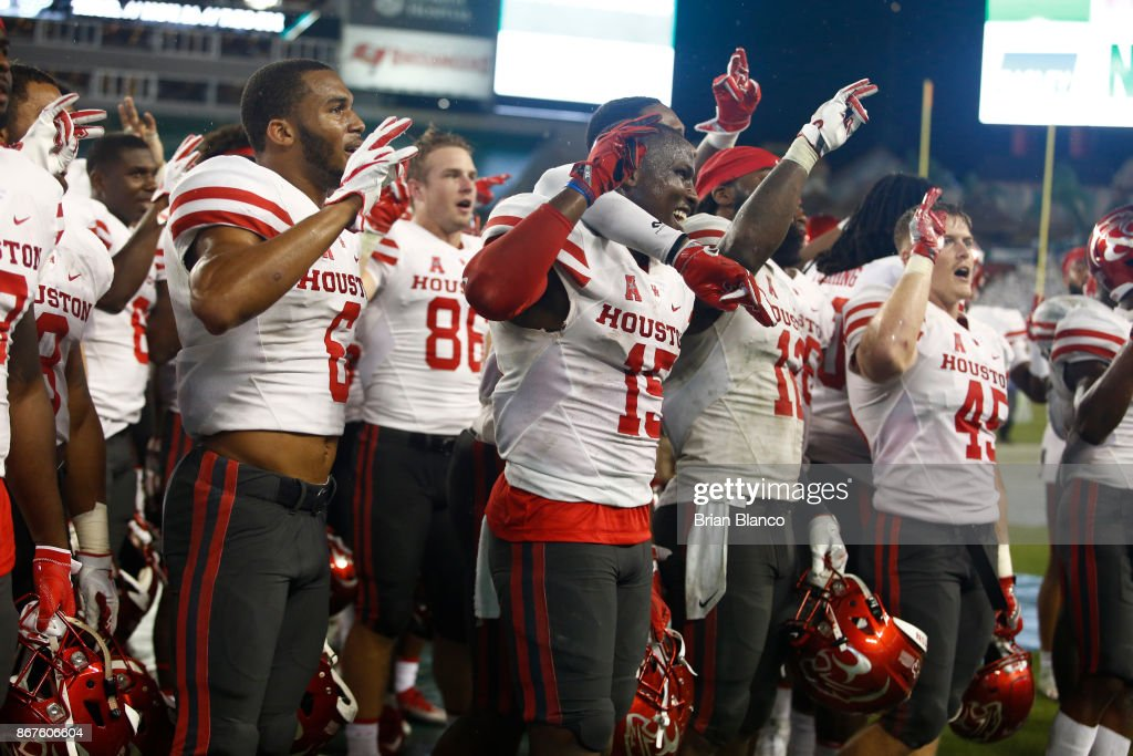 The Houston Cougars celebrate their 28-24 win over the South Florida Bulls at an NCAA football game on October 28, 2017 at Raymond James Stadium in Tampa, Florida.