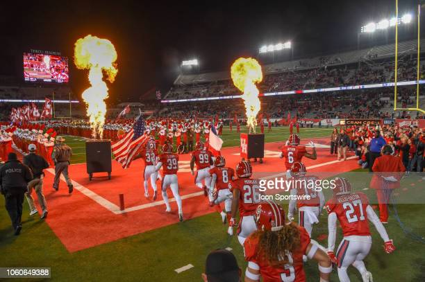 The Houston Cougars enter the field before the football game between the Temple Owls and Houston Cougars on November 10 2018 at TDECU Stadium in...