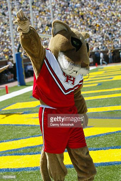 The Houston Cougars mascot cheers on the Cougar fans during a game against the Michigan Wolverines on September 6 2003 in Ann Arbor Michigan Michigan...