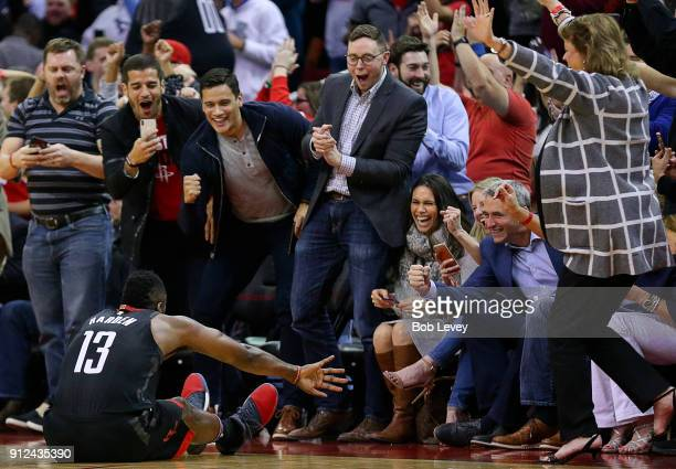 The Houston crowd courtside celebrates after James Harden of the Houston Rockets was fouled on a threepoint shot at Toyota Center on January 30 2018...