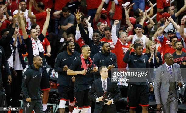 The Houston Rockets bench reacts against the Golden State Warriors late in the fourth quarter of Game Five of the Western Conference Finals of the...
