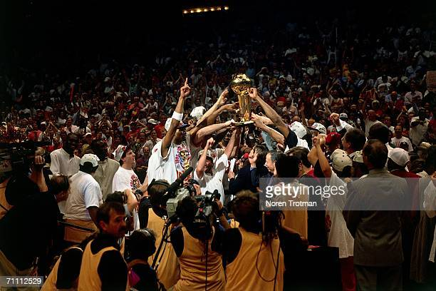The Houston Rockets celebrate at midcourt after defeating the Orlando Magic 113 to 101 in Game five of the NBA finals to win the 1995 NBA...