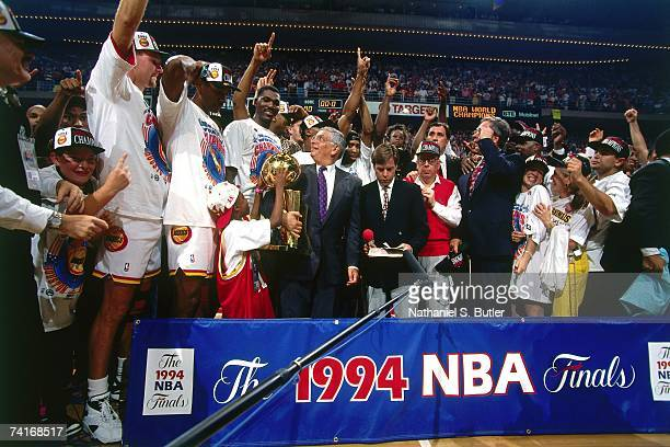 The Houston Rockets celebrate on the podium after winning the NBA Championship following Game Seven of the NBA Finals against the New York Knicks...