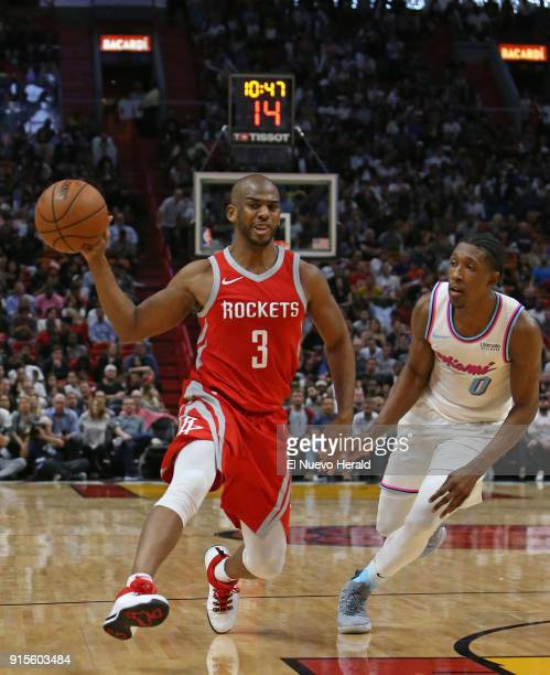 The Houston Rockets' Chris Paul passes the ball against the Miami Heat's Josh Richardson during the fourth quarter at the AmericanAirlines Arena in...