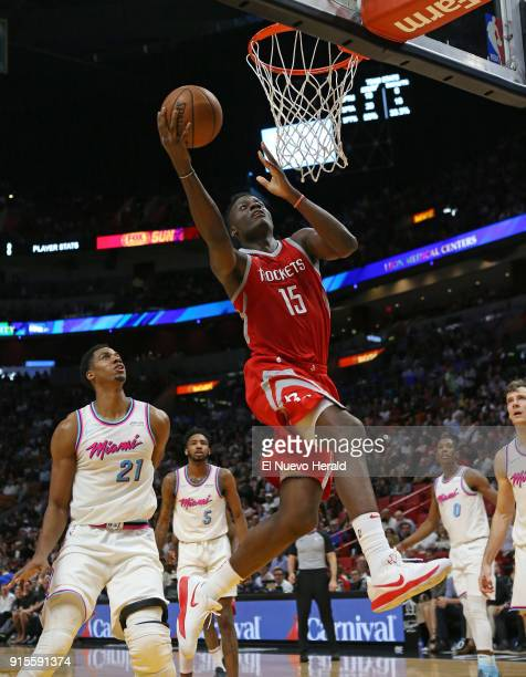 The Houston Rockets' Clint Capela goes to the basket against the Miami Heat's Hassan Whiteside during the third quarter at the AmericanAirlines Arena...