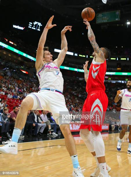 The Houston Rockets' Gerald Green right blocks a shot byt the Miami Heat's Goran Dragic during the first quarter at the AmericanAirlines Arena in...