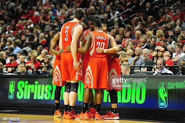 The Houston Rockets huddle during the third quarter of Game Four of the Western Conference Quarterfinals during the 2014 NBA Playoffs Portland Trail...