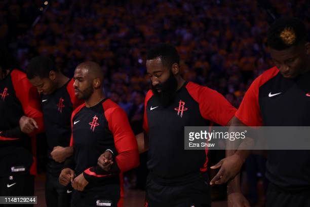 The Houston Rockets includeing Chris Paul and James Harden stand for the National Anthem before their game against the Golden State Warriors in Game...