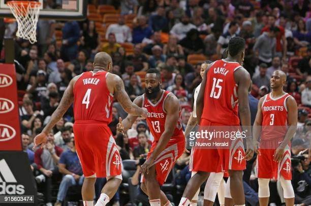 The Houston Rockets' James Harden celebrates with teammates after a play during the fourth quarter against the Miami Heat at the AmericanAirlines...