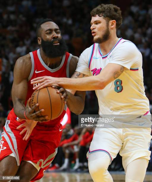The Houston Rockets' James Harden is fouled by the Miami Heat's Tyler Johnson during the fourth quarter at the AmericanAirlines Arena in Miami on...