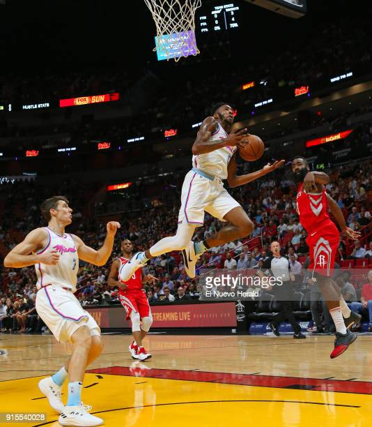 The Houston Rockets' James Harden right blocks a shot by the Miami Heat's Derrick Jones Jr during the first quarter at the AmericanAirlines Arena in...