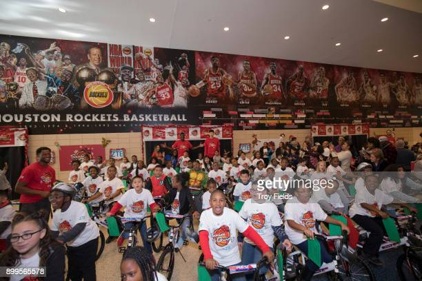 The Houston Rockets participate in the 2017 Season of Giving presented by ZTE with a holiday party and a surprise bike giveaway on December 23 2017...