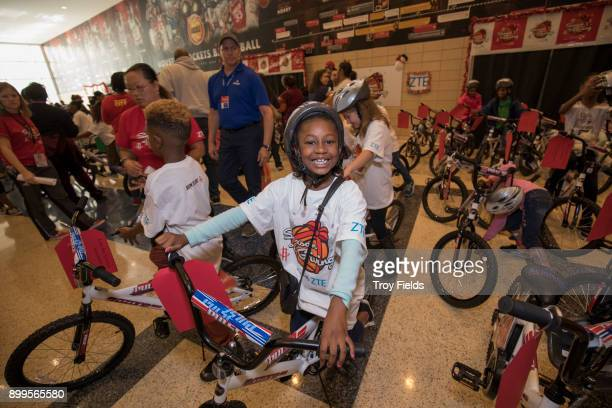 The Houston Rockets participates in the 2017 Season of Giving presented by ZTE with a holiday party and a surprise bike giveaway on December 23 2017...