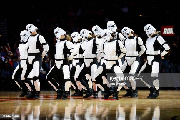 The Houston Rockets Power Dancers perform wearing stormtrooper costumes during Star Wars night during the game between the Houston Rockets and the...