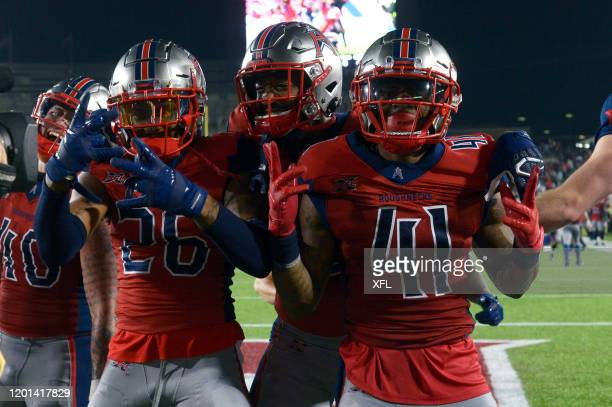 The Houston Roughnecks celebrate after Jeremiah Johnson intercepts a pass during the XFL game against the St Louis BattleHawks at TDECU Stadium on...