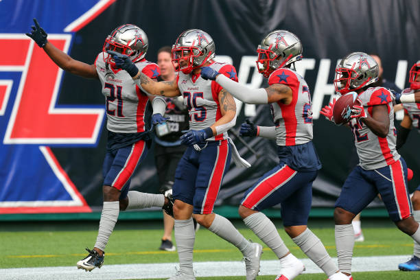The Houston Roughnecks celebrate an interception against the Dallas Renegades in the first half at an XFL football game on March 01 2020 in Arlington...