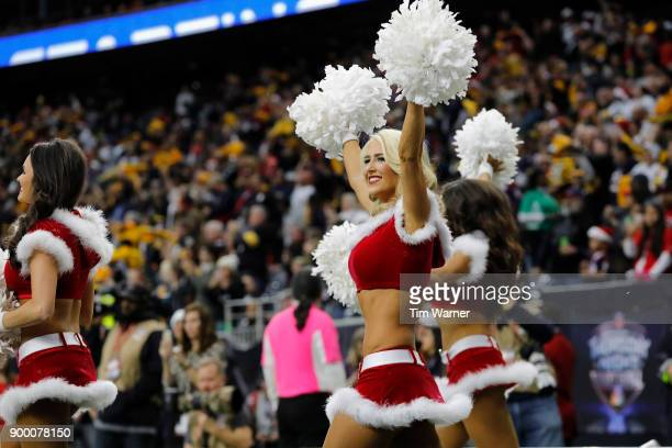 The Houston Texans cheerleaders enter the stadium before the game against the Pittsburgh Steelers at NRG Stadium on December 25 2017 in Houston Texas